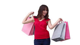 Woman walking across the screen while holding shop Stock Video Footage