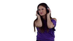 Woman dancing while listening to music through hea Footage