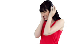 Woman dancing happily as she listens to music Stock Video Footage