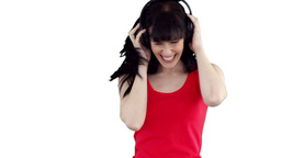 Woman dancing happily as she listens to music Footage