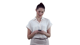 Woman pleased while using her phone Footage