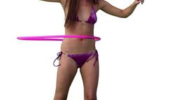 Woman in a bikini spinning a pink hula hoop Footage
