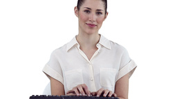 Brunette businesswoman typing on a keyboard Footage