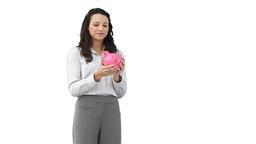 Business woman holding a piggybank Stock Video Footage