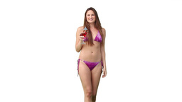 Woman in a bikini holding a drink Footage