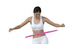 Woman using a hula hoop Footage