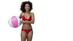 Woman playing beachball in her bikini Stock Video Footage