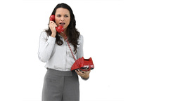 Business woman talking on a red telephone Stock Video Footage