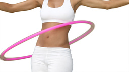 Woman using a hula hoop in her training Stock Video Footage