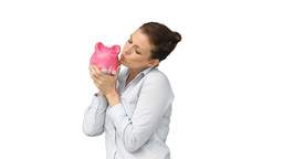 Woman rubbing and kissing her piggybank Stock Video Footage