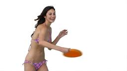 Woman playing Frisbee in her bikini Footage