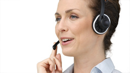 Woman using a headset to talk to a customer Stock Video Footage