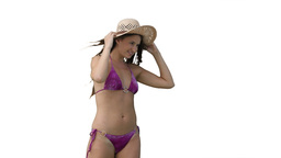 Woman in a purple bikini with her hat being blown off her head Footage