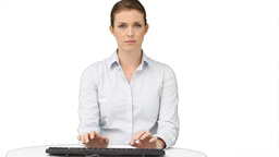 A business woman types on a keyboard Footage