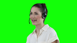 Woman using a headset to communicate Footage