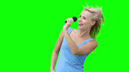 Woman dancing while singing into a microphone Footage