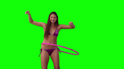 Woman playing with a hula hoop Footage