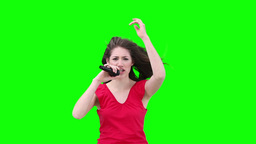 Woman singing into a microphone Stock Video Footage