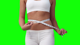 Woman measuring her waistline Stock Video Footage