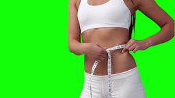Woman measuring her waistline Footage