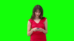Woman typing on her phone before looking to her si Stock Video Footage
