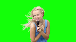 Blonde woman dancing while singing into a micropho Stock Video Footage
