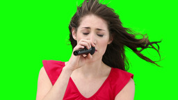 Woman singing with a microphone Stock Video Footage