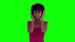 Woman swaying while listening to headphones Stock Video Footage