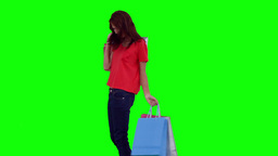 Woman swinging her shopping bags Footage