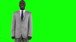 Businessman walks in before looking at the camera Stock Video Footage