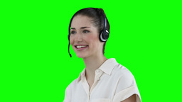 Businesswoman talking through a headset Stock Video Footage