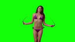 Woman playing with a skipping Footage