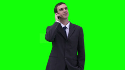 Businessman looking around while talking on a phone Stock Video Footage