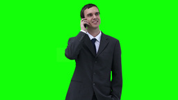 Businessman looking around while talking on a phon Stock Video Footage