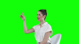 Seated businesswoman using a virtual touchscreen Stock Video Footage