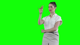 Businesswoman standing while using a virtual touch Footage