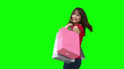 Woman smiling while holding shopping bags Footage