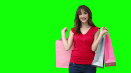 Woman smiling while holding shopping bags Stock Video Footage