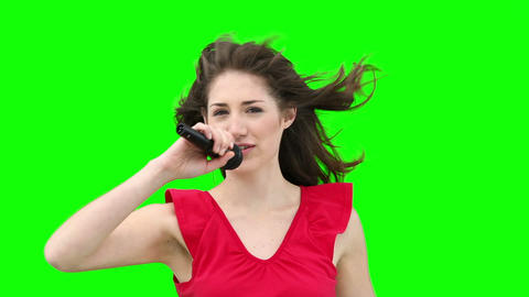 Woman waving her arms while singing into a microph Stock Video Footage