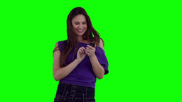 Woman smiling while typing on her phone Stock Video Footage