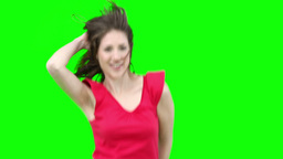Woman jumping while waving her hair Stock Video Footage