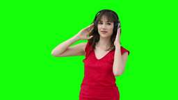 Woman swaying while holding headphones against her Footage