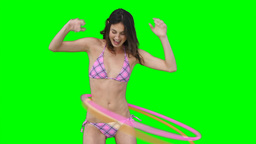 A woman playing with two hula hoops Stock Video Footage