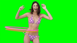 A woman playing with two hula hoops Footage