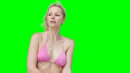 A woman moving around in her bikini Stock Video Footage