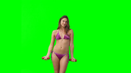 A woman in a bikini works out Footage