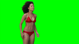 A woman throws a beachball off screen multiple times Footage