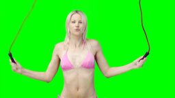A woman in a bikini skipping Stock Video Footage