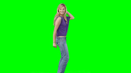 A woman dancing as she turns around Footage