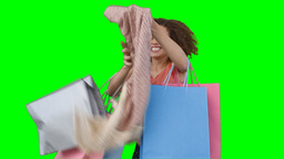 A woman with shopping trying on her scarf Stock Video Footage
